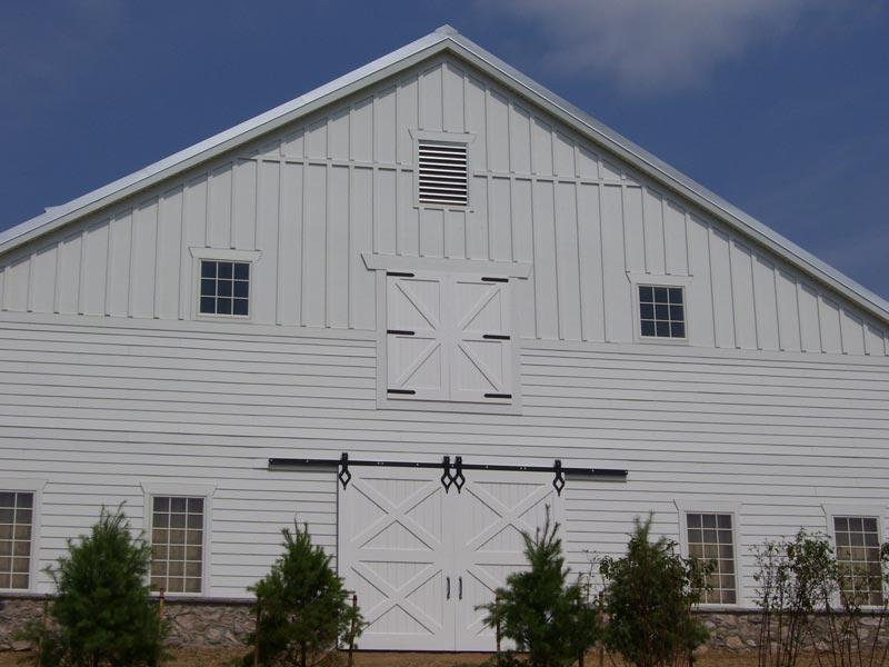 Elementary school in renovated barn building with double sliding doors with flat track hardware.