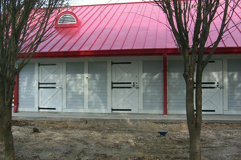 Horse barn with heavy duty strap hinges on dutch doors.