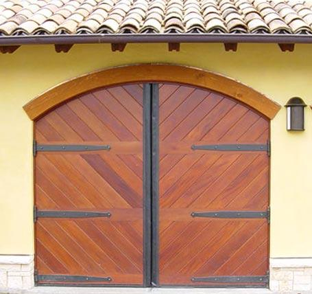 Decorative heavy duty strap hinges on garage doors.