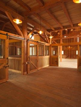 Stable with flat track hardware for individual horse stalls.
