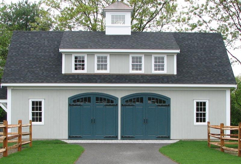 Heavy duty decorative surface mount hinges on garage doors.