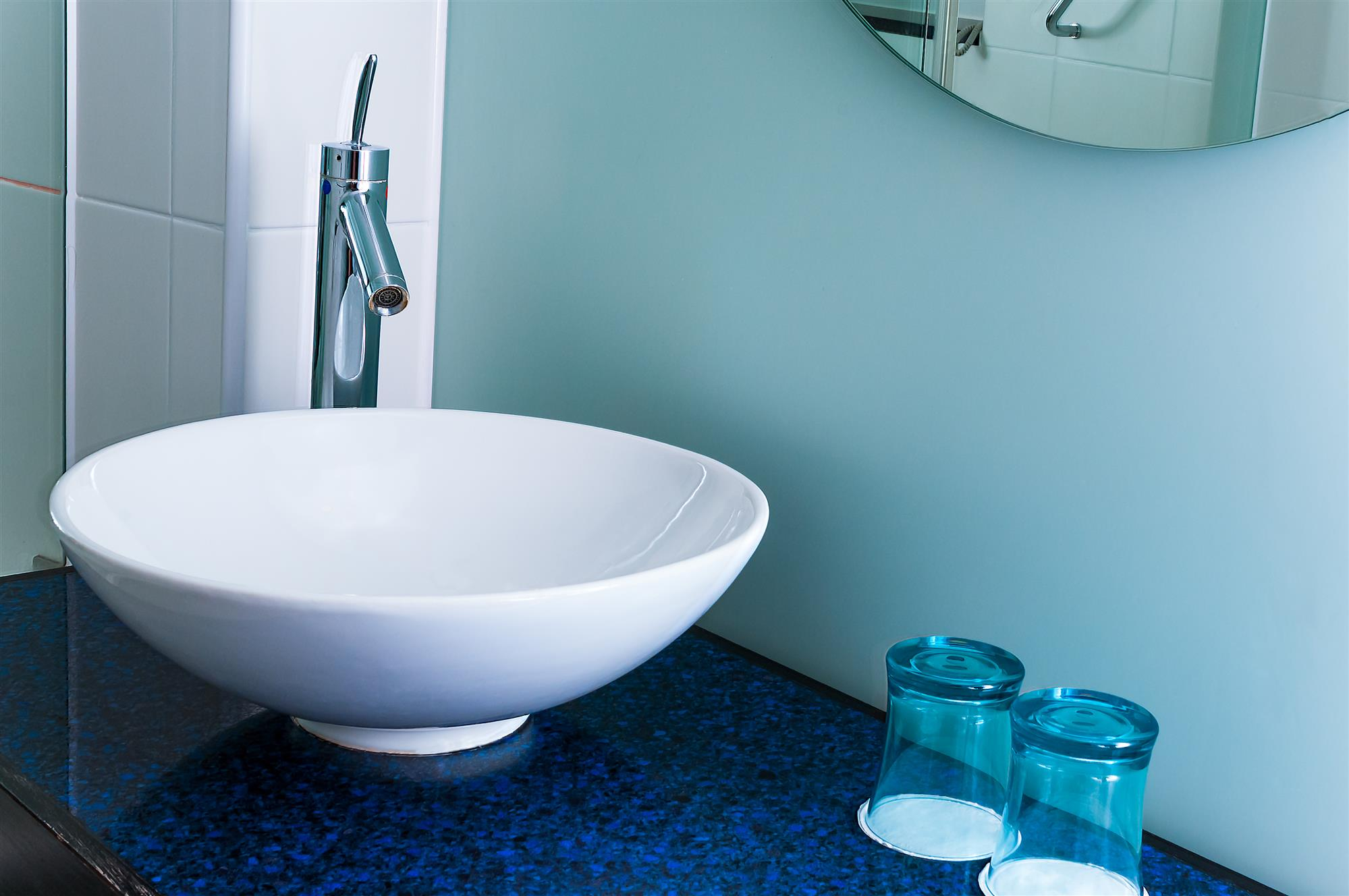 Bathroom sink with blue countertop